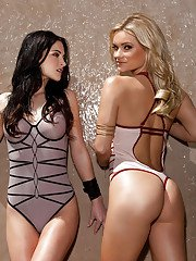 Sexy centerfold babe Katie Carroll posing and striping with her girlfriend