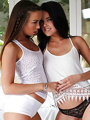 Sex-hungry teenage sweeties have some lesbian fun on the bed