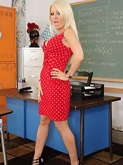 Steaming hot teacher Helly Hellfire getting naked in the classroom
