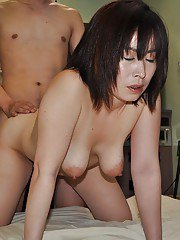 Horny asian lady Yumi Ohno gives head and gets her hairy cunt boned-up