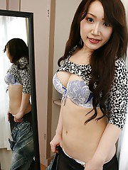 Cute asian teen Makoto Mukai undressing and spreading her lower lips