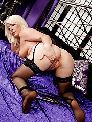 Sassy blonde MILF with tempting curves getting rid of her lingerie