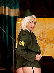 Mature blonde army lady in stockings takes off her uniform and lingerie