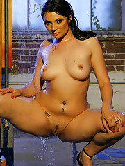 Tempting brunette babe Ava Rose performs wet and steamy posing scene