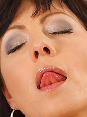 Bosomy mature gal Jane Black fingering and toying her shaved twat