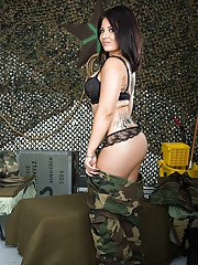 Hot MILF in military uniform uncovering her tempting tattooed curves