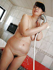 Chubby asian MILF with hairy pussy Norie Shibamura taking shower and bath