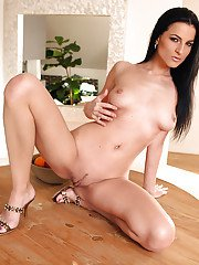 Raven-haired chick undressing and showcasing her graceful curves