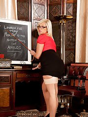 Tempting blonde teacher in glasses revealing her goods at her workplace