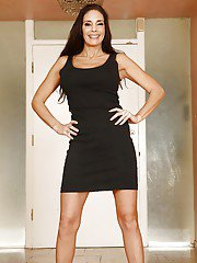 Smiley MILF with hot curves gets rid of her dress and lingerie