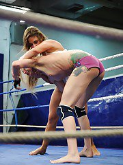 Rough catfight turning into fervent lesbian sex right on the wrestling floor