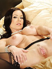 Busty MILF Kendra Lust undressing and spreading her nylon clad legs