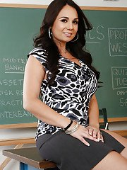 Tempting latina teacher Holly West getting nude up against the chalkboard