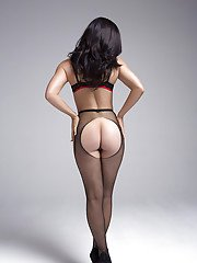 Wooing brunette in sexy pantyhose taking off her lacy lingerie top