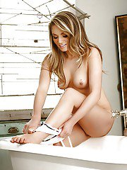 Luscious babe Emma Jones taking off her lingerie and taking bath