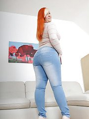 Redhead mature plumper in blue jeans undressing and spreading her legs