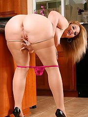 Fatty mature housewife in stockings gets rid of her dress and lingerie