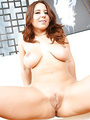 Big busted MILF takes off her tiny bikini and gets her big butt oiled up