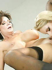 Sultry mature bombshell has some lesbian fun with her younger friend