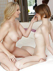 Slippy teenage hottie has some dirty fun with her mature lesbian friend