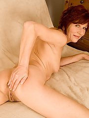 Sassy redhead mature lady undressing and spreading her legs