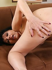 Lascivious mature brunette pleasing her hairy cunt with a vibrator