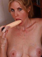 Sexy blonde MILF with round jugs pleasing her cunt with a ribbed toy