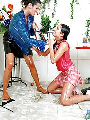 Dirty-minded fetish chicks have some slimy fully clothed catfight fun