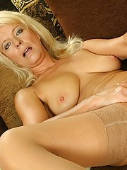Naughty mature lady with nice tits undressing and toying her trimmed pussy
