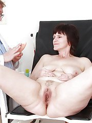 Fatty mature brunette with massive tits gets examed by a naughty gyno