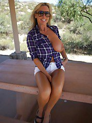 Smiley blonde mature babe in sunglasses flashing her gorgeous boobs outdoor