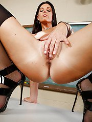 Lusty teacher undressing and teasing her slit in the classroom