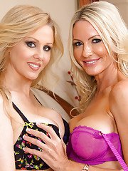 Stunning blonde MILFs in lingerie make some stripping and humping action
