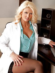 Mature blonde doctor getting rid of her dress clothes and teasing her vag