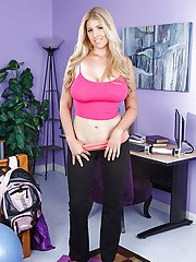 Tempting blonde with curvaceous body taking off her sport outfit