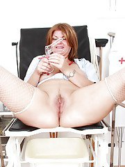 Lustful mature nurse stuffing her soaking twat with vibrator and gyno tool