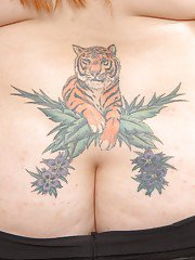 Tattooed redhead plumper getting nude and exposing her shaved gash