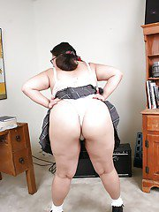 Fatty asian gal in school uniform undressing and teasing her shaved gash