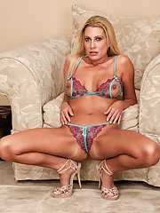 Juggy blonde MILF taking off her bikini and toying her hungry gash