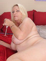 Mature gal gets rid of her lingerie and pantyhose and masturbates her gash