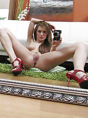 Frisky chick undressing in front of the mirror and making selfies
