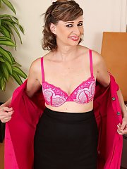 Lusty mature office gal stripping and exposing her pink twat in close up