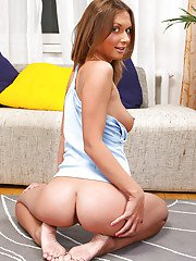 Playful teenage floosie slowly uncovering her tempting curves