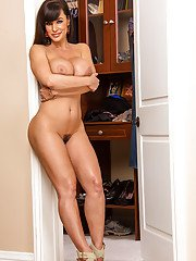 Curvaceous brunette MILF stripping down and spreading her legs