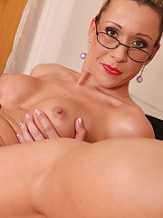 Hot MILF in glasses posing nude on her office desk and showcasing her vag