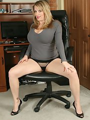 Curvaceous MILF undressing and caressing herself in the office