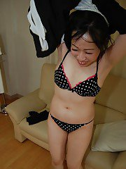 Smiley asian teen in pantyhose getting nude and teasing her hairy slit