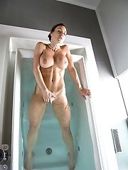 Stupendous MILF undressing and teasing her pussy in the bathtube