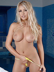 Steamy blonde doxy taking off her undies and playing with herself