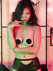 Graceful asian babe in stockings boots uncovering her tempting curves